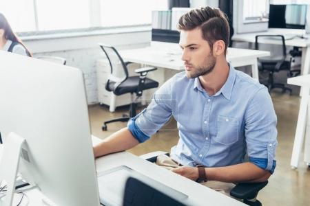 Businessman using desktop computer