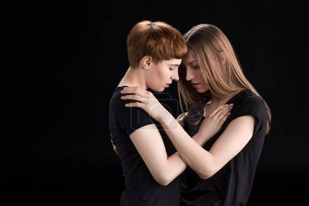 lesbian couple touching foreheads