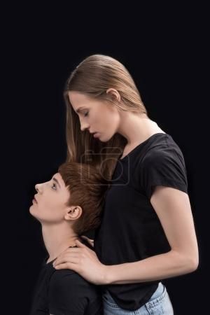 Photo for Half-length shot of young woman holding shoulders of her girlfriend while standing behind - Royalty Free Image