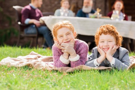 Kids resting on green grass