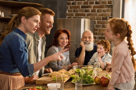Photo for Happy multigeneration family preparing dinner together in kitchen - Royalty Free Image