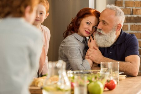 Photo for Selective focus of sensual senior couple in kitchen at home - Royalty Free Image