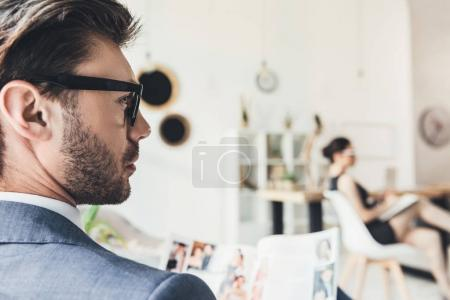 Young businessman sitting in office