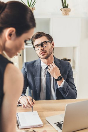 Businessman looking at beautiful secretery