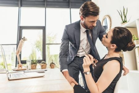 Business couple flirting