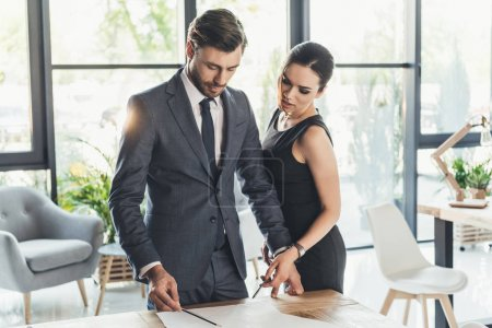 Businesspeople discussing work