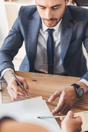 Businessman signing paperwork