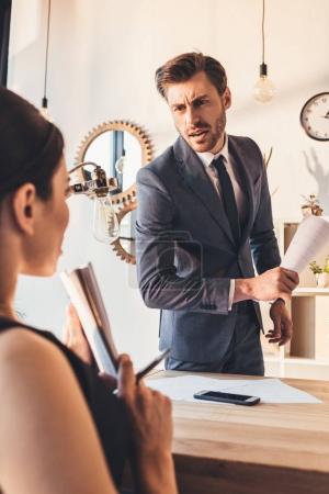 Businessman reprehending secretery