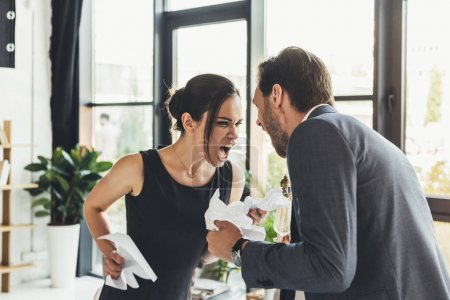 businesspeople screaming at each other