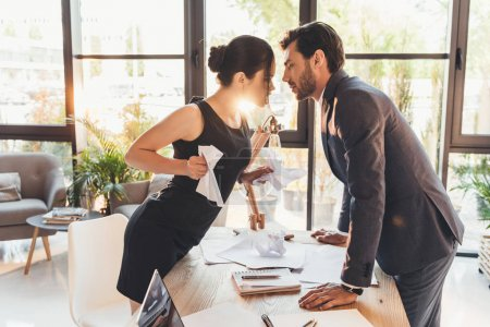 Couple having argument in office