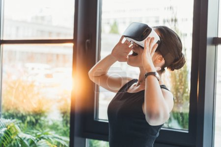 businesswoman with virtual reality glasses