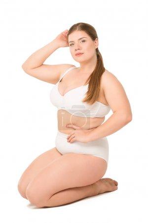 overweight woman posing in white underwear