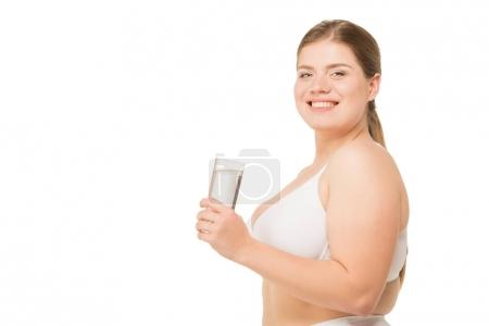 smiling overweight woman with water