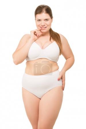 cheerful overweight woman in underwear