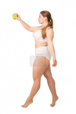 overweight woman holding apple