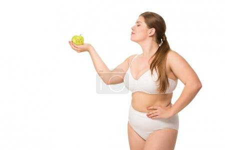 Fat woman holding apple