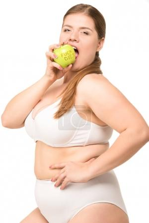 overweight woman eating apple