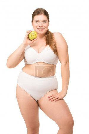Fat smiling woman with apple