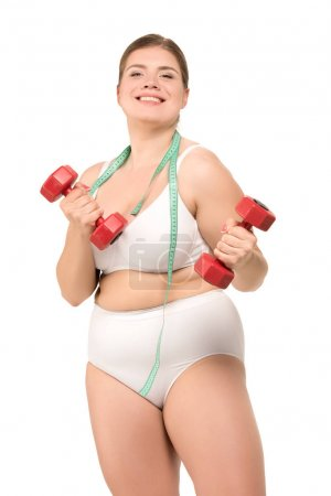 overweight woman training with dumbbells