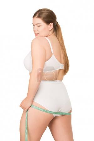 overweight woman measuring butt
