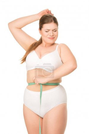 woman measuring waist