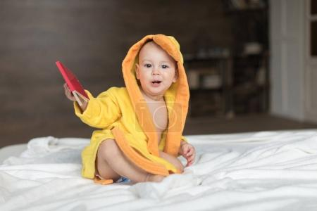 Baby boy in yellow robe