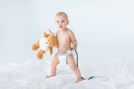 Baby boy with teddy bear