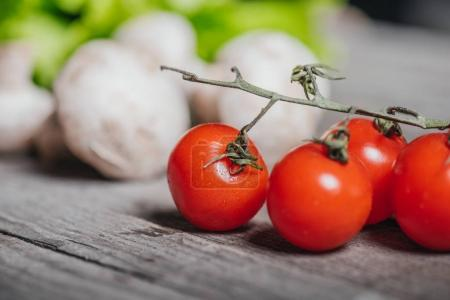Photo for Close up of cherry tomatoes with mushrooms and salad on wooden table, cherry tomatoes salad - Royalty Free Image