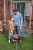 father and son on barbecue