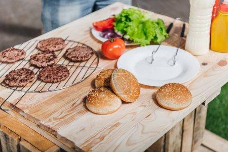 Burgers ingredients on table