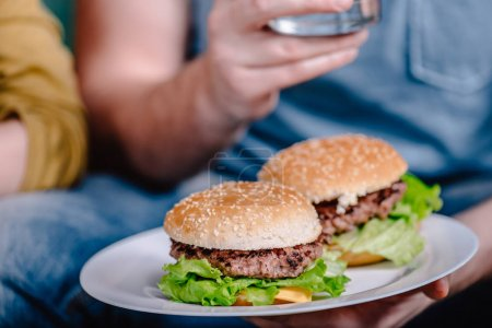 Photo for Close up view of homemade meat burgers on plate - Royalty Free Image