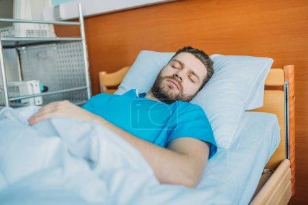 sick man sleeping on hospital bed