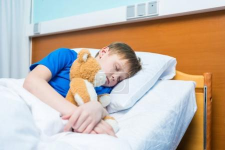 Little boy in hospital bed