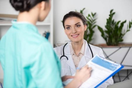 internist talking with doctor