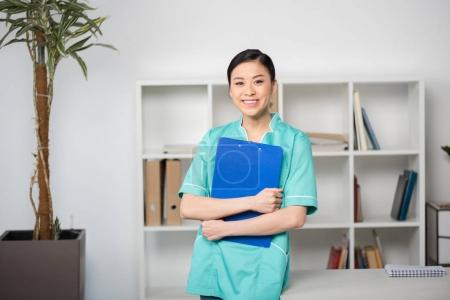 Internist holding clipboard with diagnosis