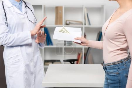 Patient giving money to doctor 3