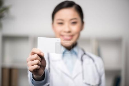 doctor showing blank card