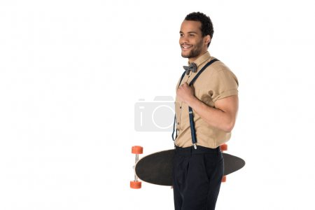Stylish young man with skateboard