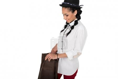 Young woman with leather bag