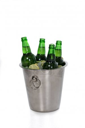 Bucket full of ice and beer bottles