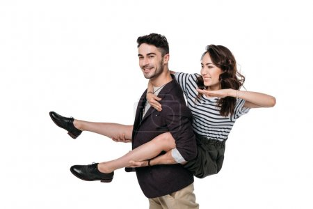 Photo for Young casual couple fooling around and doing piggyback isolated on white - Royalty Free Image