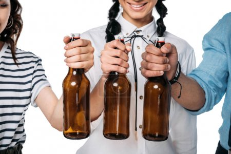 Young people holding empty bottles