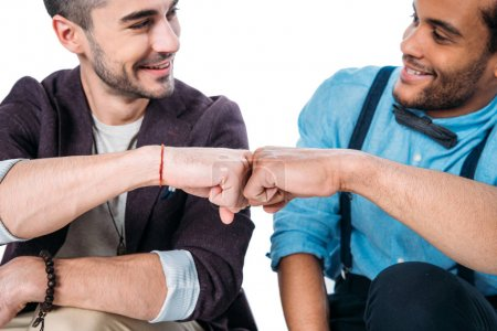 friends smiling and doing fist bump