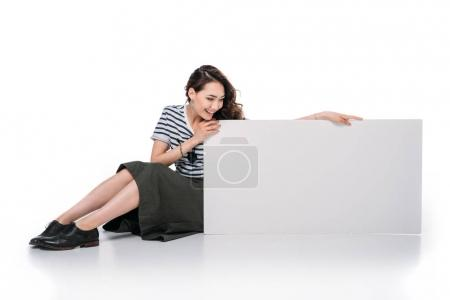 Photo for Young asian woman sitting and holding blank board - Royalty Free Image