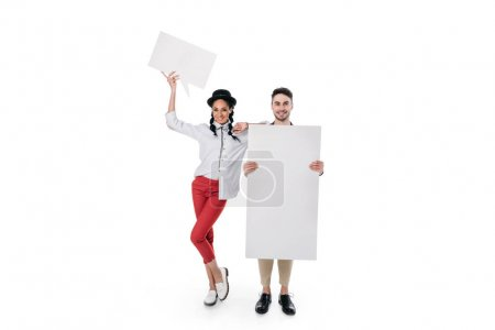 young couple holding blank banners