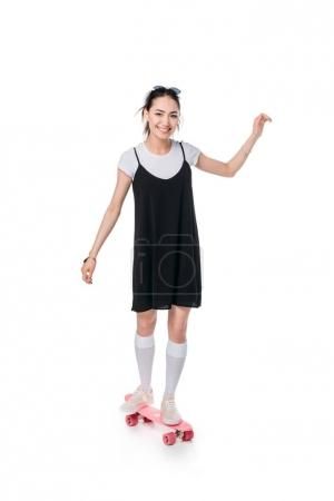 casual asian girl riding on skateboard
