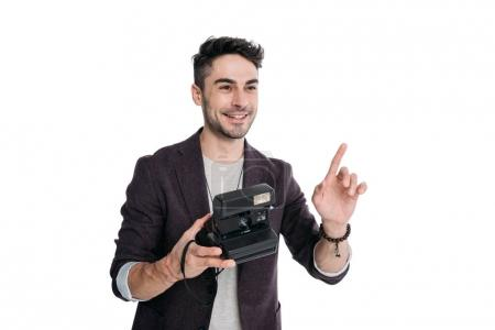 Photo for Smiling man taking photo with instant vintage camera isolated on white - Royalty Free Image