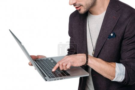 Photo for Cropped shot of stylish man typing on laptop isolated on white - Royalty Free Image