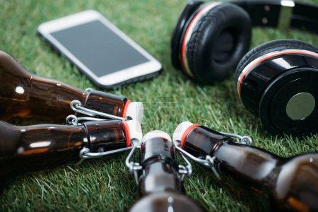 Beer bottles with smartphone and headphones