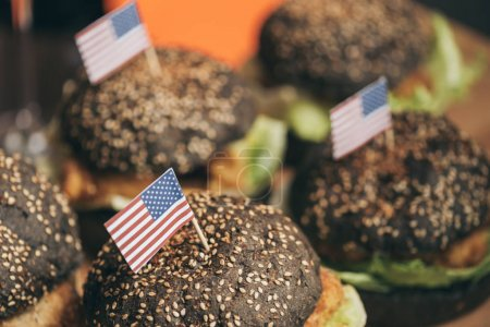 Tasty burgers with american flags